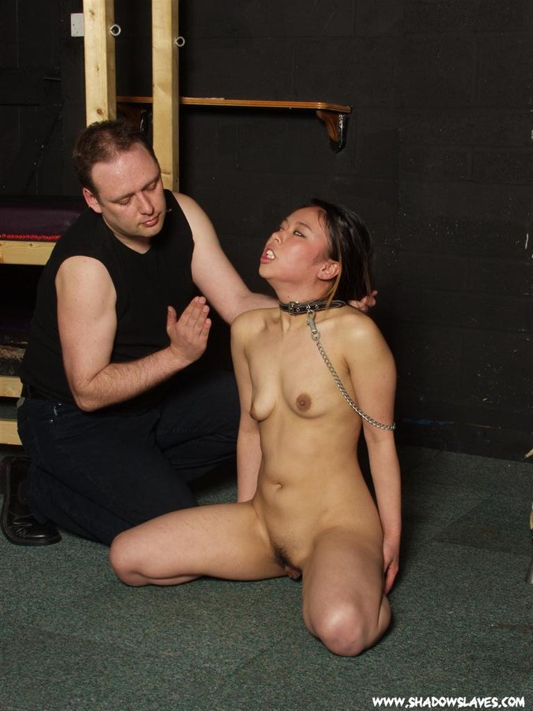 Asian female slave humiliated